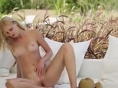 blond beauty rubbing pussy in fields