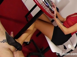 Sluty secretary is dressed in tan pantyhose and mini skirt. Her boss likes to be her office slave. First secretary gives him a shoejob and continues with footjob until he cums.