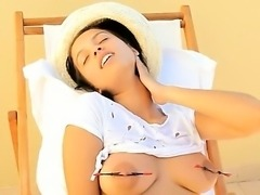 Busty beauty torturing her nipples