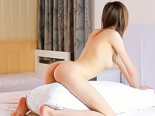 Petite hot girl Glorie fingers her muff as she caress her nude sexy body till...