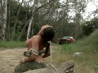 Naked and tied Charity Bangs is left behind of the dusty road and when the...