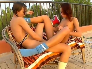 Turned on slender teen lezzies Ivana and Natasha with tight bodies get naked...