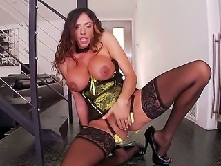 Dirty and nasty whore Ariella Ferrara revealing her huge and lovely boobs feeling horny is masturbating her wild pussy while wearing a corset and her favorite black stockings.
