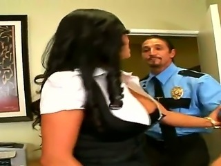 Huge tittied brunette milf Mariah Milano is giving fellatio to police officer...