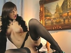 Nina Young likes playing with her sweet pussy and she takes her favourite sex toy and fucks her cunt with it making it wet and very juicy and cums spectacularly at the end!
