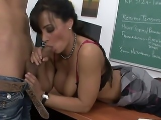 Chris Johnson pleases horny teacher Lisa Ann by deep licking and fucking her...