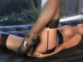 Mesmerizing Emily Addison in exciting lingerie caressing her pussy with full...