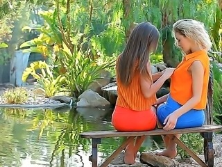 Two young girlfriends Guerlain and Madonna are getting horny outdoors by the...