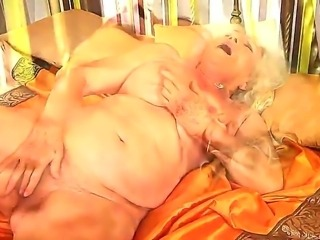 Granny with extremely hairy pussy named Norma rubs it with a new toy in the afternoon