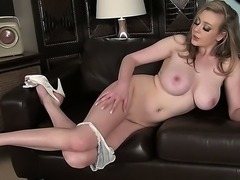 Sapphire Blue is a big titted blond seductress. She has plenty of sex toys...