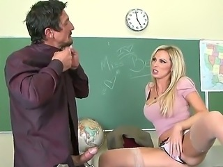 The sexy Nikki Benz with the colossal tits sucks with a pleasure a her...
