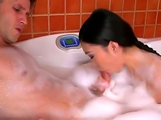 Asian brunette Nicoline enjoys having a hot bath along horny male with hard cock