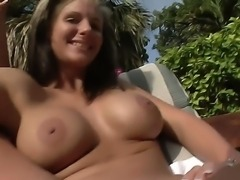 Hot busty milf pornstar Phoenix Marie enjoys in laying naked in her garden...