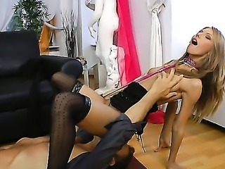 Rocco Siffredi works out a juicy asshole of an unprincipled anal slut Abby H in a pink neck collar and black stockings while he is being dominated by her black hihg heels.