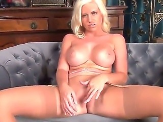 The glamorous blonde Chloe Dee demonstrates her colossal tits and masturbates...