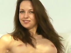 Long haired young looking brunette hottie Aneta J. with stunning green eyes...
