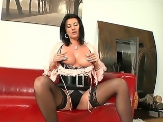 Hot lesbian slut enjoys fucking her wet pussy with huge tits.