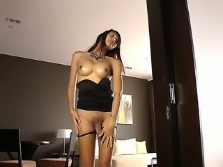 Absolutely amazing and cute ladyboy - Candise masturbates her fucking cock while lying on the bed, she is so horny, definitely worth to see at this gorgeous slut and her cock!