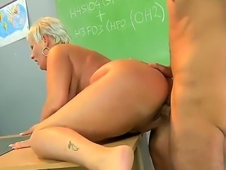 Filthy ass licking short haired blonde granny Cecily in high heels only seduces her handsome student and gets her wet twat licked and fucked hard to loud orgasm in classroom.