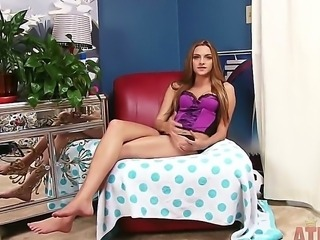 Cute brunette Kennedy Nash in lingerie strips and plays with her feet on the bed in bedroom