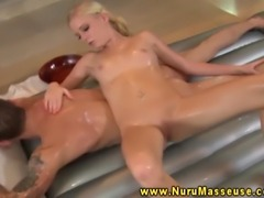 Blonde masseuse babe sucks dudes cock and massaging him with a lot moisture