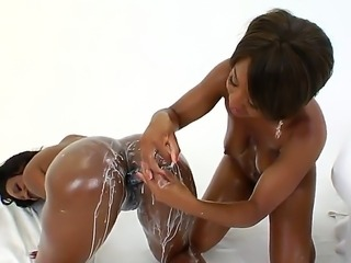 Amazing and exquisite ebony sluts Imani Rose and Nyomi Banxx pouring milk on...