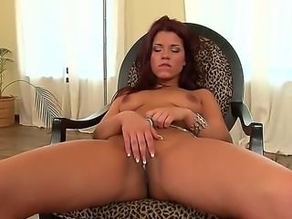 Today we bring you a bewitching babe with sexy tanned skin and dark red hair! Her named is Angelique and she willingly spreads her long legs masturbating her beautiful pussy!