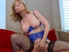 Busty milf Nina Hartley demonstrates her