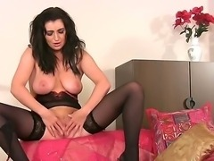 Glamour babe Tibby undresses in front of the camera and dance the striptease....