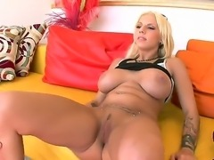 Arresting buxom blonde Lylith Lavey really has something under her clothes to surprise us