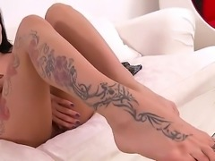 Exotic black haired hottie Isla with nice body and large arousing tattoo...