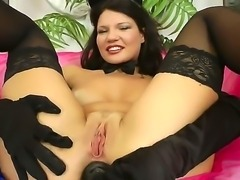 Slutty chick in black stockings Helen Kroff is spreading legs wide, taking her favorite dildo and stuffing ass by it. She sucks huge cock after that and gets it in ass too.