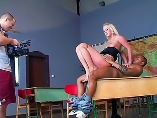Great backstage scene right in the classroom with sexy blonde teacher and her black student