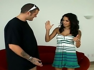 Freaky dude with two dicks is getting them deepthroated by a hot brunet whore