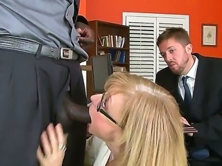Bespectacled mature lady Nina Hartley in