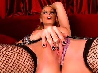 sexy blonde Sandy looks hot and horny as does an erotic striptease for you. Watch as this babe with great perky titties lays back and spreads her stocking clad legs. her panties dissapear into her as she pulls them up tight. Then you can see as her finger plunges deep into her moist young hole.