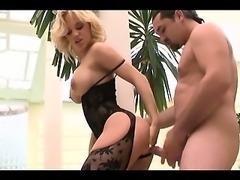 Busty milf fucking in a black nylon bodystocking