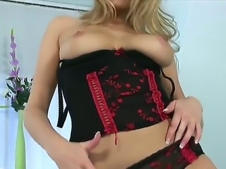 The fantastic sexy and glamorous blonde Zoe McDonald in seductive lingerie shows us her body