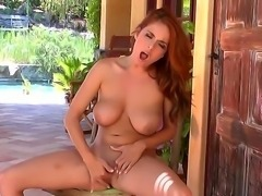 Awesome redhead porn star Ashley Graham with big natural boobs, caressing her...
