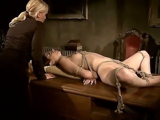 Kathia shows no mercy, as she dildofucks the hogtied slave girl. Jeanines wrists are still burning after letting her go - this domination session is not something to forget!