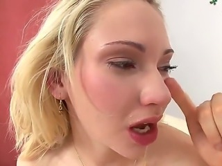 Blonde hottie Sara Monroe has a monster cock deep inside her tiny mouth