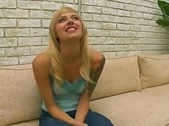 The sympathetic blonde babe Emma Mae with a small tits demonstrates her body...