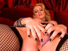 Sexy and dangerous bitch named Sandy dances and plays with her shaved pussy