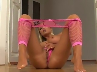 Blond bitch wearing sexy pink lingerie likes to tease and pet her shaved pussy