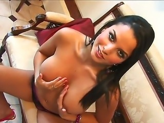 Lusty dark haired Sasha in provocative sexy lingerie enjoys in fingering her shaved taco on the sofa