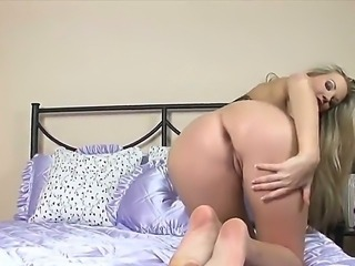 The gorgeous blonde babe Jana M with a small tits demonstrates her body and plays with a dildo