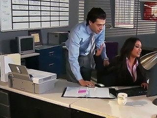 Priya and Xander are both fighting for the same position at Glubbert Financial. In a battle of wits, tits and dicks the two proceed to fuck each others brains out all over the office in order to settle the score.