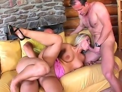Cock hungry blonde Mia Leone with huge fake hooters and heavy make up in high...