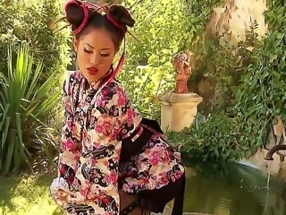 Danika is an insanely hot Asian babe and today she will treat us with a seductive solo performance. She is posing outdoor in her kimono and opens it so we could see her perfect titties and ass.