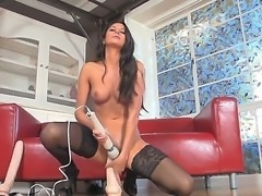 Horny brunette in hot stockings Nikki Daniels enjoys masturbating with a huge...